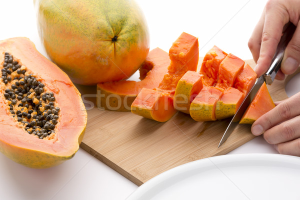 Cutting A Papaya Quarter Into Six Slices Stock photo © leowolfert