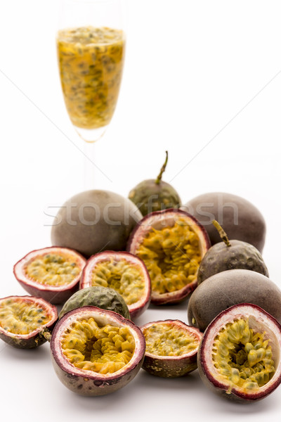 Passion Fruit Flesh In Its Rind And In A Glass Stock photo © leowolfert