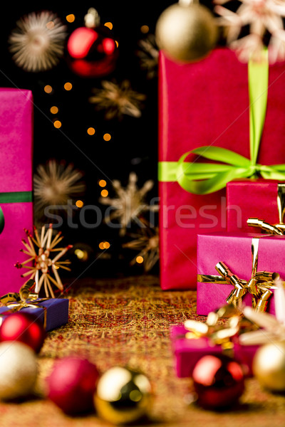 Xmas Background with Gifts, Stars and Spheres Stock photo © leowolfert