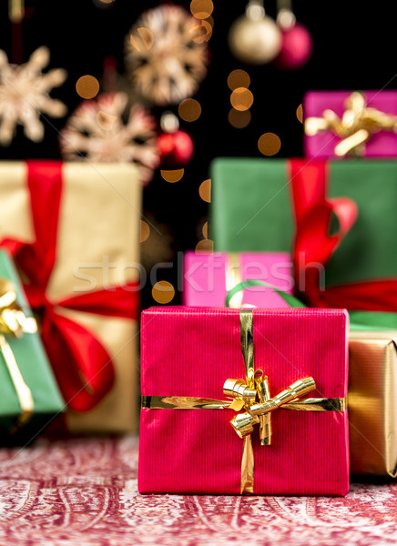 Christmas Background with Gifts and Glitters Stock photo © leowolfert