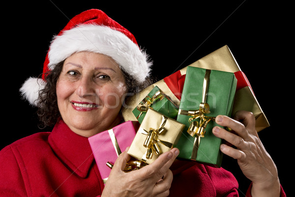 Mature Lady Holding Up Five Christmas Presents
