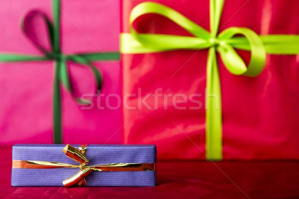 Blue gift with golden bowknot Stock photo © leowolfert