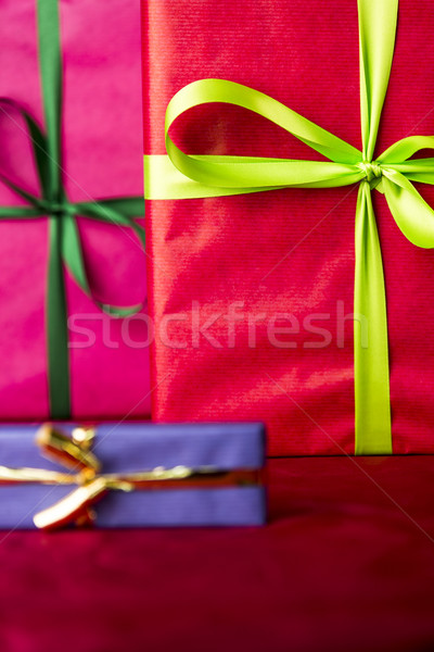 Green bowknots on red gift wrapping