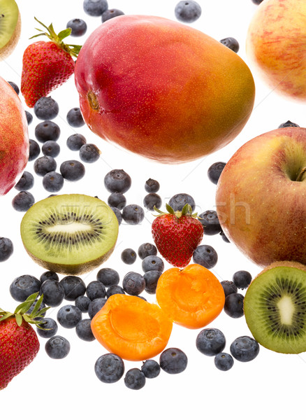 Vertical Closeup Of Assorted Fruits On White Stock photo © leowolfert