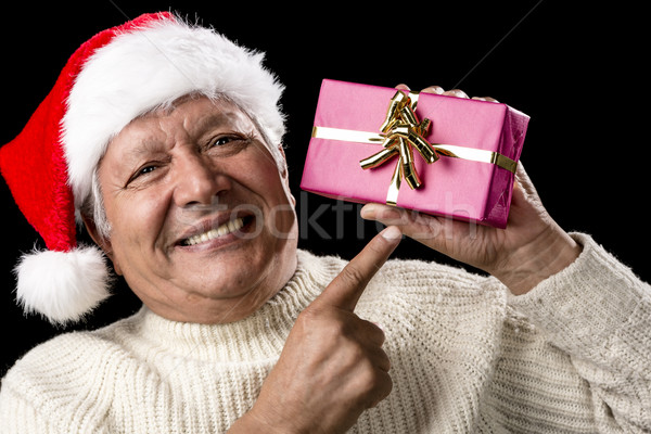 Aged, But Vivid Gentleman Pointing At Wrapped Gift Stock photo © leowolfert