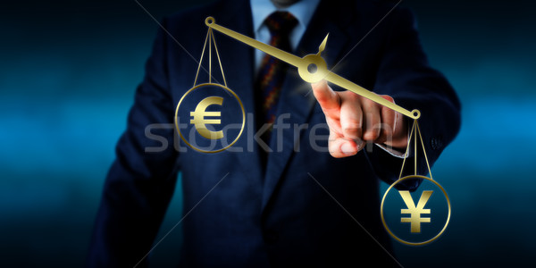 Yuan Sign Outweighing The Euro On A Golden Scale Stock photo © leowolfert