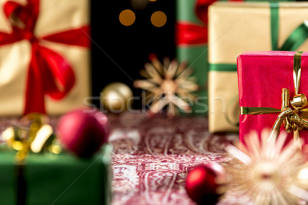 Christmas Gifts Placed on a Festive Cloth Stock photo © leowolfert