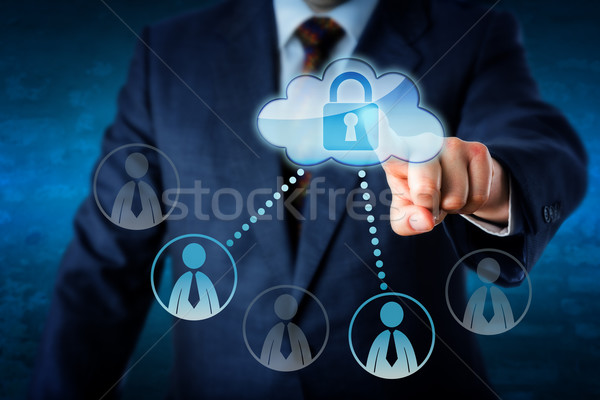 Executive Touching Locked Cloud Linked To Peers Stock photo © leowolfert
