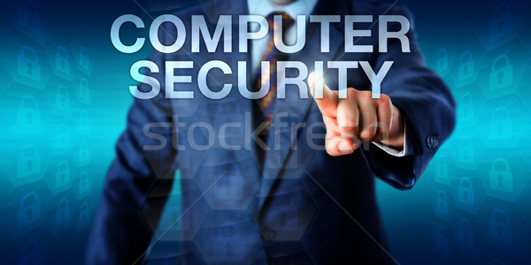 Manager Pushing COMPUTER SECURITY Onscreen Stock photo © leowolfert