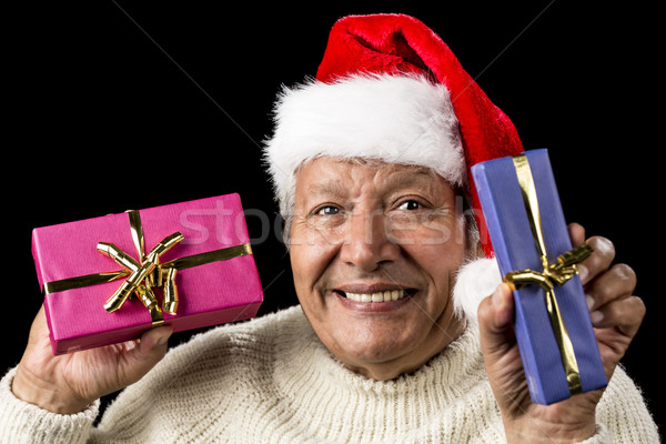 Lighthearted, Smiling Old Man Offering Two Gifts Stock photo © leowolfert