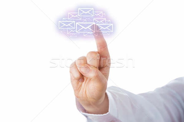 Touching A Swarm Of Email Icons Forming A Cloud Stock photo © leowolfert