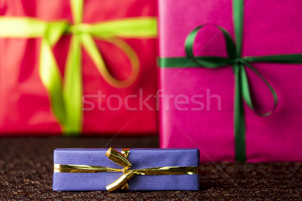 Three presents, bows and ribbons