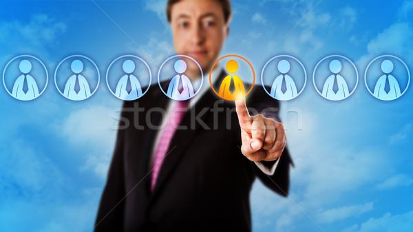 Menedzser választ egy munkás nyolc toborzás Stock fotó © leowolfert