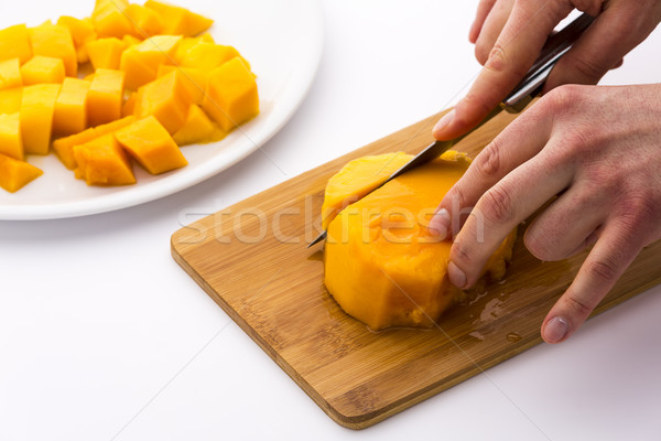 Cutting The Middle Mango Third Containing Its Pit Stock photo © leowolfert