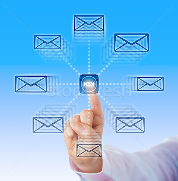Index Finger Sending Email Icons Into Cyber Space Stock photo © leowolfert