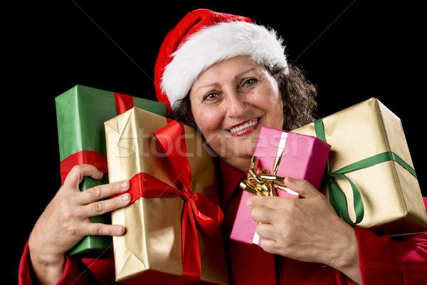 Lächelnd Frau vier Geschenke Stock foto © leowolfert