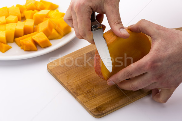 Peeling The Middle Mango Slice With The Fruit Pit Stock photo © leowolfert