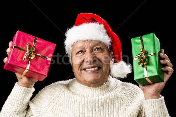 Poignant Aged Man Showing Red And Green Xmas Gifts Stock photo © leowolfert