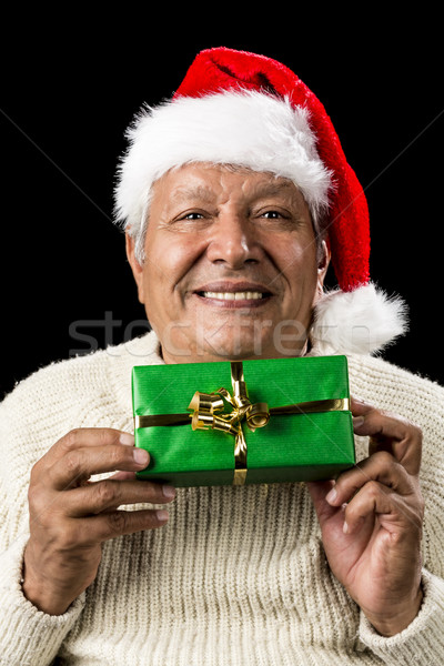 Smiling Old Man Handing Over A Wrapped Green Gift Stock photo © leowolfert
