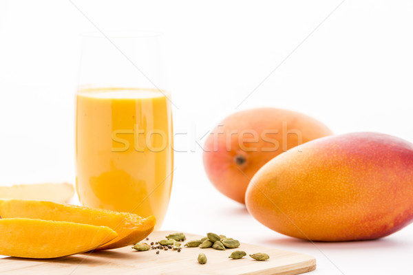 Mangos, Cardamon And Mango Yoghurt Drink On White Stock photo © leowolfert