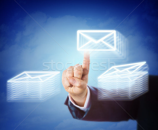 Hand Moving Email Between Two Document Stacks Stock photo © leowolfert
