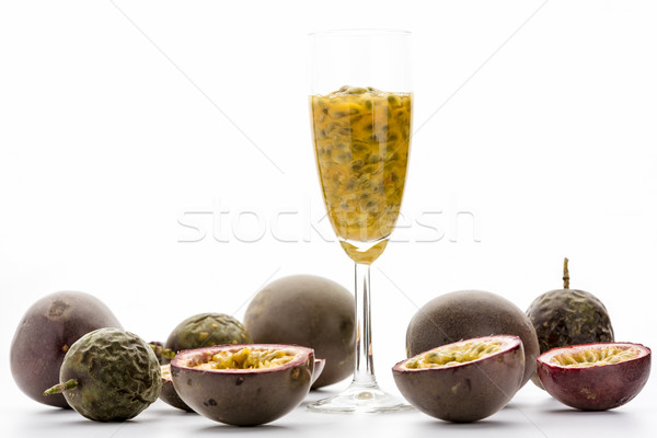 Passion Fruit Pulp In A Glass Amidst Ripe Fruits Stock photo © leowolfert
