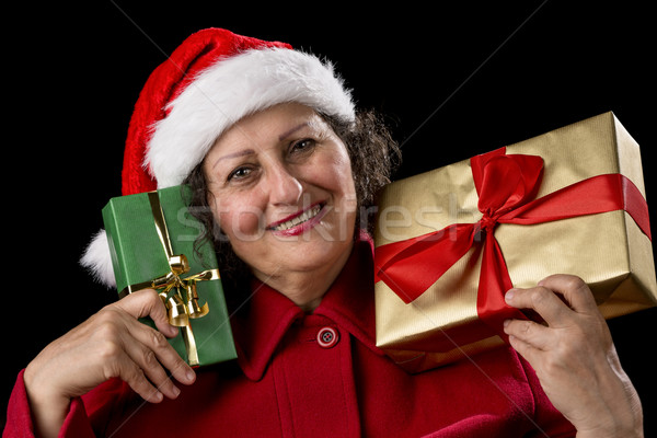 Smiling Lady with Golden and Green Christmas Gifts Stock photo © leowolfert