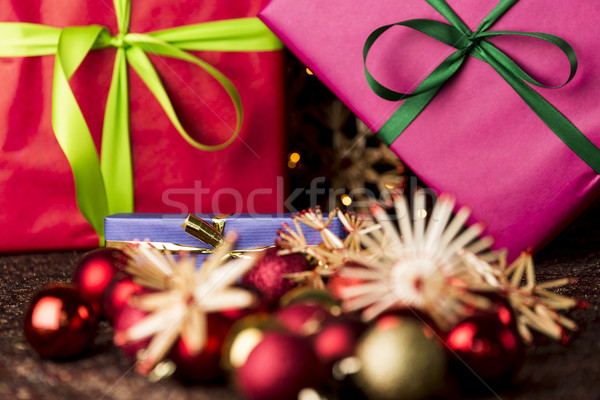 Ribbons, gifts, baubles and straw stars Stock photo © leowolfert