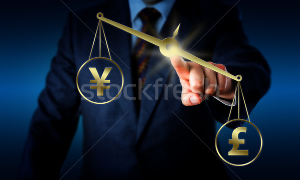 Pound Sterling Outweighing The Yuan On A Balance Stock photo © leowolfert