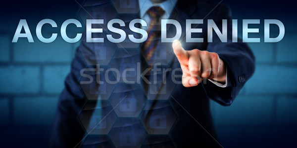 Businessman Pointing At ACCESS DENIED Stock photo © leowolfert