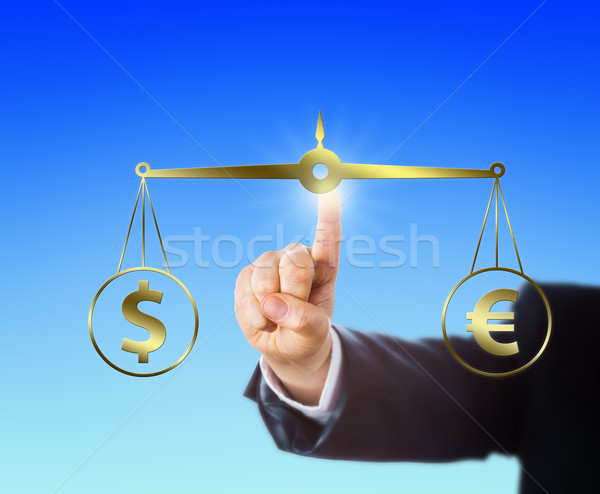 Finger Equating A Dollar At Par With A Euro Sign Stock photo © leowolfert