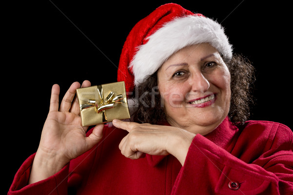 Happy Old Woman with Red Cap Points at Xmas Gift Stock photo © leowolfert