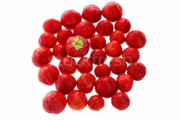 Big Strawberry Standing Out From The Crowd Stock photo © leowolfert