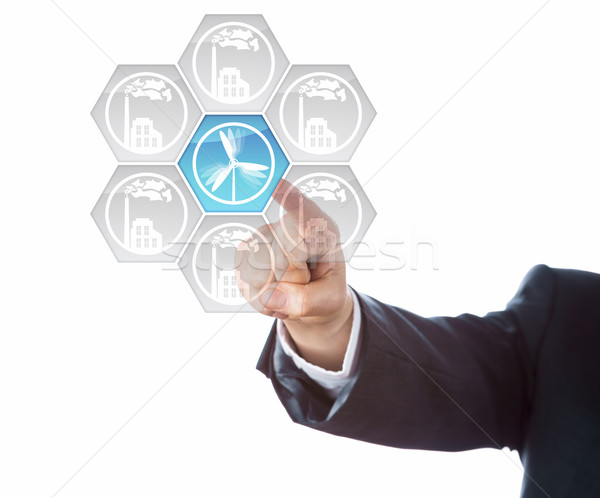 Hand Of Business Man Dialing-In Wind Energy Icon Stock photo © leowolfert
