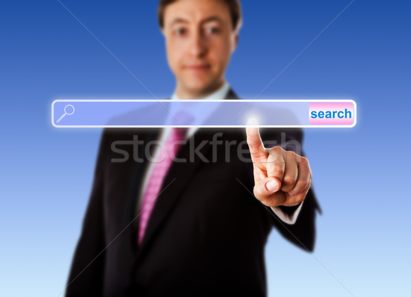 Smiling Manager Touching An Empty Search Bar Stock photo © leowolfert