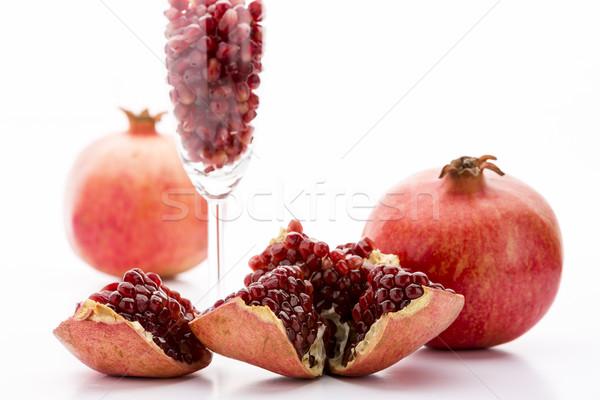 Pomegranate and its seeds Stock photo © leowolfert