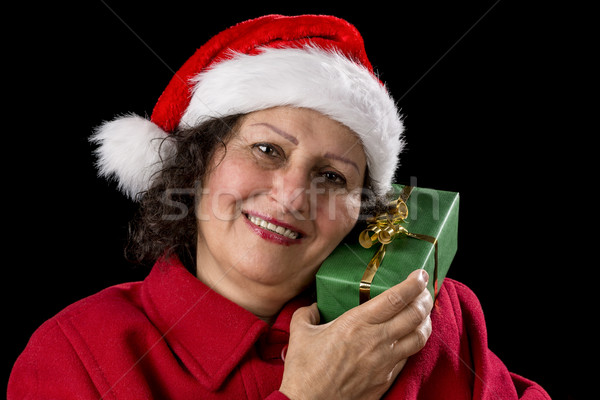 Senior Lady with Santa Claus Hat and Wrapped Gift Stock photo © leowolfert