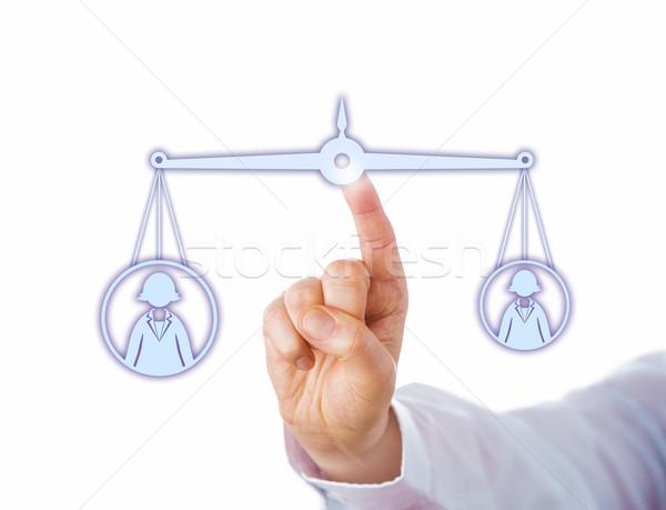 Balancing A Big Versus A Small Female Worker Stock photo © leowolfert