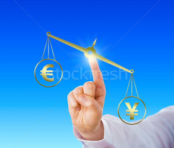Yen Sign Outweighing The Euro On A Golden Scale Stock photo © leowolfert