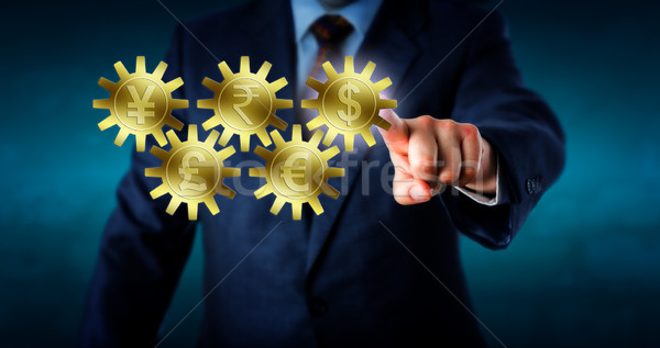 Major Currencies Interlocking Like A Gear Train Stock photo © leowolfert