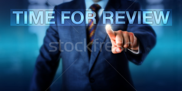 HR Manager Pressing TIME FOR REVIEW Stock photo © leowolfert