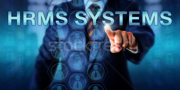 HR Manager Pushing HRMS SYSTEMS Onscreen  Stock photo © leowolfert