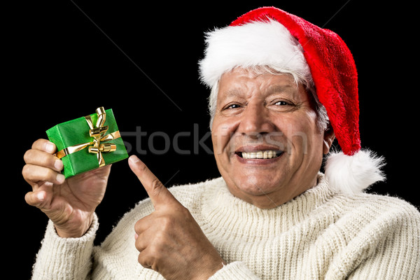 Cheerful Old Man Pointing At Green Wrapped Gift Stock photo © leowolfert