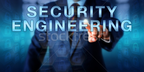Software Engineer Touching SECURITY ENGINEERING Stock photo © leowolfert
