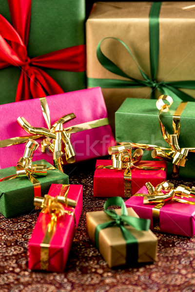 Nine Wrapped Presents in Plain Colors