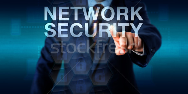 Administrator Touching NETWORK SECURITY Onscreen Stock photo © leowolfert