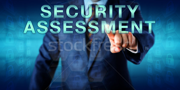 Consultant Touching SECURITY ASSESSMENT Onscreen Stock photo © leowolfert