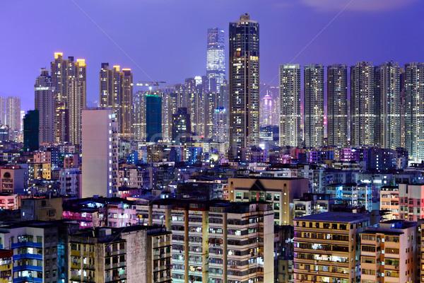 crowded building at night in Hong Kong Stock photo © leungchopan