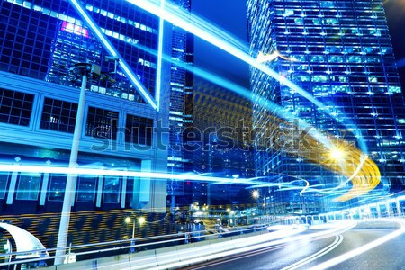 Traffic trail in commercial district Stock photo © leungchopan