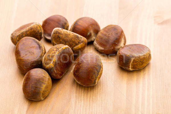 Castaño mesa madera fondo Shell frescos Foto stock © leungchopan
